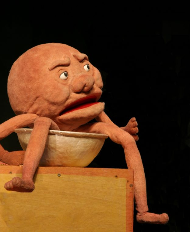 Puppet of Albert the Magic Pudding sitting in his pudding bowl